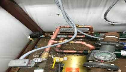 bigstock-Plumber-At-Work-In-A-Bathroom-235131790